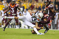 Landover, MD - September 3, 2017: West Virginia Mountaineers wide receiver David Sills V (13) gets tackled by Virginia Tech Hokies defensive back Mook Reynolds (6) during game between Virginia Tech and WVA at  FedEx Field in Landover, MD.  (Photo by Elliott Brown/Media Images International)