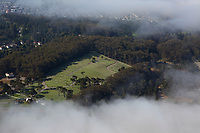 aerial photograph of the San Francisco National Cemetery through layers of fog, Presidio, San Francisco, California