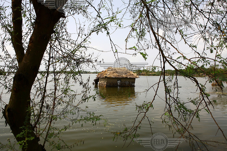 A lone house sits half-submerged in the floodwaters. Thousands of people were displaced in Shyamnagar Upazila, Satkhira district after Cyclone Aila struck Bangladesh on 25/05/2009, triggering tidal surges and floods..