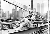 New York, New York USA, June 1979 - French singer Sylvie Vartan sitting on the Brooklyn Bridge. She recently released her first album in the US and was in New York City to promote it.