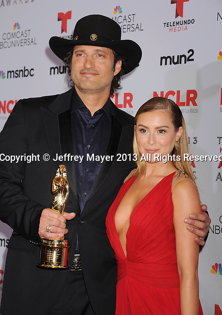 PASADENA, CA- SEPTEMBER 27: Director Robert Rodriguez and actress Alexa Vega pose in the press room at the 2013 NCLA ALMA Awards at Pasadena Civic Auditorium on September 27, 2013 in Pasadena, California.