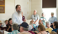 NWA Democrat-Gazette/BEN GOFF @NWABENGOFF<br /> Andrew Albers leads the Northwest Arkansas Sacred Harp Singers in a traditional song Saturday, June 30, 2018, during a grand opening for the renovated Shiloh Meeting Hall in downtown Springdale. Constructed in 1871, the building served as a home to multiple church congregations, fraternal organizations and other community functions over it's lifetime. In 2005 the Independent Order of Odd Fellows donated the building to the Shiloh Museum of Ozark History for it's restoration and preservation. The restored first floor will again be used by community groups and the museum for functions, and will be available to rent for events. The second floor, expected to open in 2020, will be an exhibit hall telling the story of the building and the history of the organizations that have called it home.