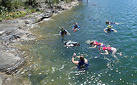 NWA Democrat-Gazette/FLIP PUTTHOFF<br /> A LOOK DOWN UNDER<br /> Snorkelers swim along a rocky shorline at Beaver Lake in the Rocky Branch area Wednesday August 12 2015 during a snorkel tour offered by Hobbs State Park-Conservation Area. or Snorkelers traveled in the park's pontoon boat to a scenic cove in the Rocky Branch area of Beaver Lake and explored along a rocky shoreline. The park's next snorkeling trip is August 19 from 1 to 4 p.m. The $20 cost includes use of a snorkel, mask and life jacket. Call the Hobbs visitor center, 479-789-5000 to register.