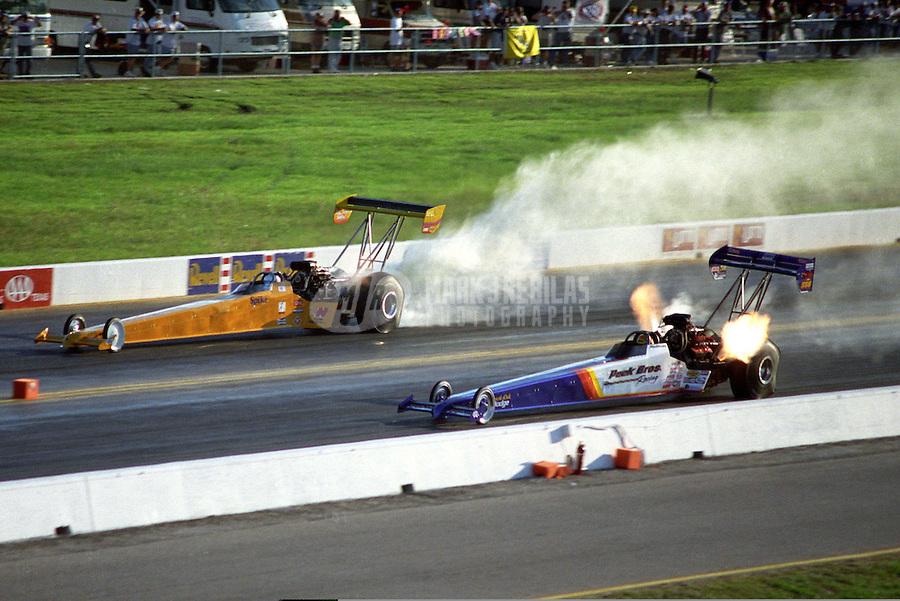Oct. 19, 1997; Ennis, TX, USA; NHRA top fuel dragster driver Tony Schumacher (right) races alongside Spike Gorr during the Revell Nationals at the Texas Motorplex. Mandatory Credit: Mark J. Rebilas-