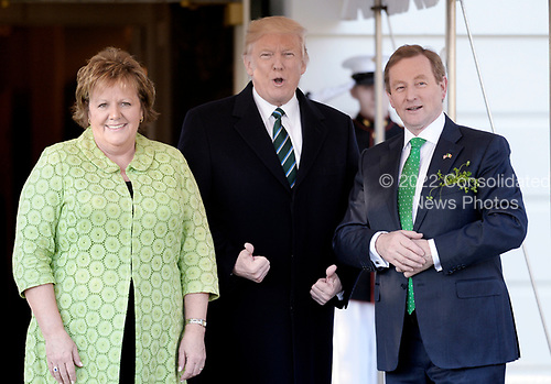 United States President Donald J. Trump  welcomes Prime Minister Enda Kenny of Ireland and his wife Fionnuala Kenny on the South Portico of the White House in Washington, DC on March 16, 2017 in Washington, DC. <br /> Credit: Olivier Douliery / Pool via CNP