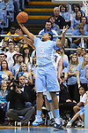 31 December 2013: North Carolina's Kennedy Meeks grabs a rebound. The University of North Carolina Tar Heels played the UNC Wilmington Seahawks at the Dean E. Smith Center in Chapel Hill, North Carolina in a 2013-14 NCAA Division I Men's Basketball game. UNC won the game 84-51.