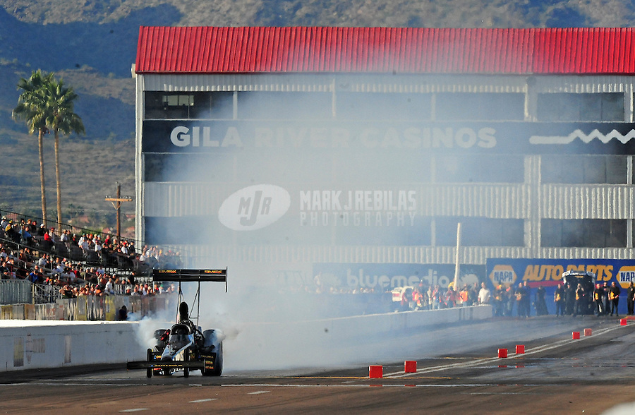 Jan 24, 2009; Chandler, AZ, USA; NHRA top fuel dragster driver Troy Buff blows an engine during testing at the National Time Trials at Firebird International Raceway. Mandatory Credit: Mark J. Rebilas-