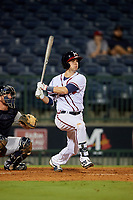 Mississippi Braves third baseman Daniel Lockhart (17) follows through on a swing in front of catcher Michael Barash (16) during a game against the Mobile BayBears on May 7, 2018 at Trustmark park in Pearl, Mississippi.  Mobile defeated Mississippi 5-0.  (Mike Janes/Four Seam Images)