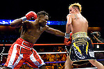Uncasville, CT: (l-r) Lovemore N'Dou lands on Paulie Malignaggi  during their IBF Junior Welterweight Championship at the Mohegan Sun casino, June 16th, 2007. Malignaggi won the belt from N'Dou by unanimous decision.. Photo by Thierry Gourjon.