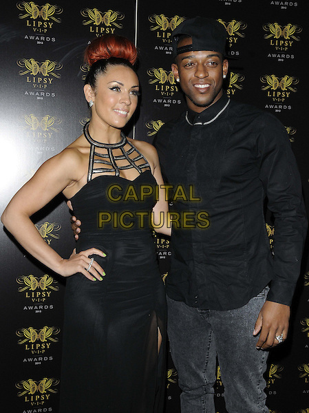 Amy Jane of VIDA &amp; Oritse Williams of JLS<br /> The Lipsy VIP Fashion Awards 2013, DSTRKT, Rupert St., London, England.<br /> May 29th, 2013<br /> half length black shirt backwards baseball cap hat dress jeans denim hand on hip<br /> CAP/CAN<br /> &copy;Can Nguyen/Capital Pictures