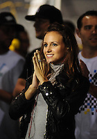 May 1, 2009; Richmond, VA, USA; Samantha Sarcinella girlfriend of NASCAR Nationwide Series driver Kyle Busch (not pictured) cheers during the Lipton Tea 250 at the Richmond International Raceway. Mandatory Credit: Mark J. Rebilas-