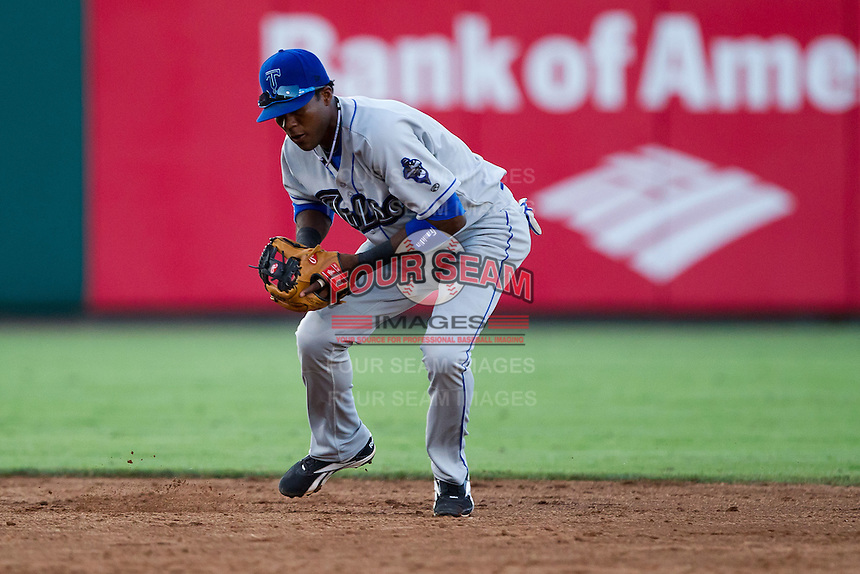 Hector Gomez (5) of the Tulsa Drillers fields a ground ball during a game against the Springfield Cardinals at Hammons Field on July 18, 2011 in Springfield, Missouri. Tulsa defeated Springfield 13-8. (David Welker / Four Seam Images)
