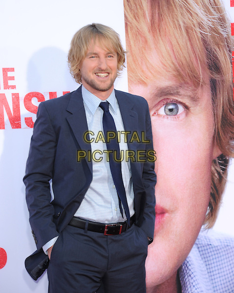 Owen Wilson<br /> &quot;The Internship&quot; Los Angeles Premiere held at the Regency Village Theatre, Westwood, California, USA.<br /> May 29th, 2013<br /> half length shirt check tie stubble facial hair beard suit blue hands in pockets <br /> CAP/RKE/DVS<br /> &copy;DVS/RockinExposures/Capital Pictures