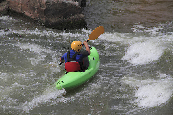 Kayaker on Boulder Creek, Boulder, Colorado. .  John offers private photo tours in Denver, Boulder and throughout Colorado. Year-round.