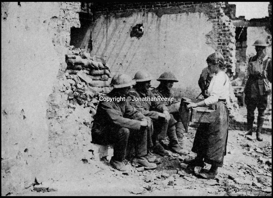 BNPS.co.uk (01202 558833)<br /> Pic: JonathanReeve/BNPS<br /> <br /> A young Frenchwoman offering for sale chocolate and cigarettes to British soldiers, June 1917.<br /> <br /> The meals that fuelled the British soldiers to victory in the trenches during the First World War have been revealed in a new book.<br /> <br /> And unlike the popular idea of just bully beef and tea, it reveals a suprising varied if largely unappetising mixture that included egg and chips, along with more challenging fare including gruel, calves foot jelly, and onion porridge.<br /> <br /> Then there was the dreaded Maconochie stew, which had been a standard part of rations since the Boer War. <br /> <br /> This watery stew consisted of turnips and vegetables, with minimal meat. Although it was recommended that the tin was warmed prior to eating, it was mostly eaten cold. <br /> <br /> One unfortunate side-effect was it caused flatulence amongst the ranks.<br /> <br /> The huge logistical challenge faced when attempting to keep millions of troops fed and watered is revealed in Hannah Holman's book The Trench Cookbook 1917.