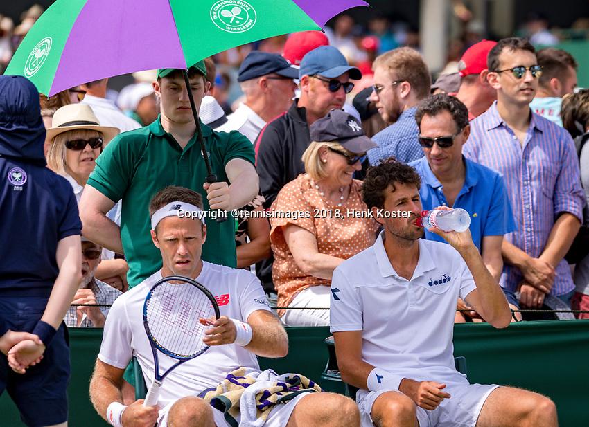 London, England, 4 th. July, 2018, Tennis,  Wimbledon, Men's doubles: Robin Haase (NED) Robert Lindstedt (SWE) (L)<br /> Photo: Henk Koster/tennisimages.com