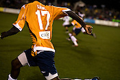 "March 14, 2009. Cary, NC.. The Carolina Railhawks went home in foul weather with a  1-0 victory over the New England Revolution of the MLS, in the inaugural ""Community Shield"" match and their first professional outing under new coach, Martin Rennie. . #17, Joseph Kabwe."