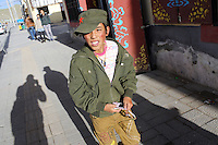 A Tibetan boy in a town on the Tibetan Plateau, in western China.