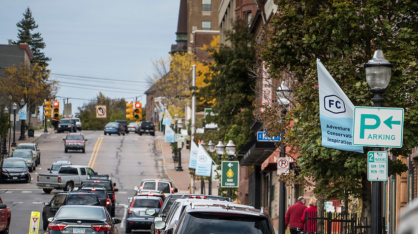 Lampost flags mark downtown Marquette, Michigan in preparation for the Fresh Coast Film Festival. The festival, held annually in October, celebrates the outdoor lifestyle and environment of the Great Lakes region.