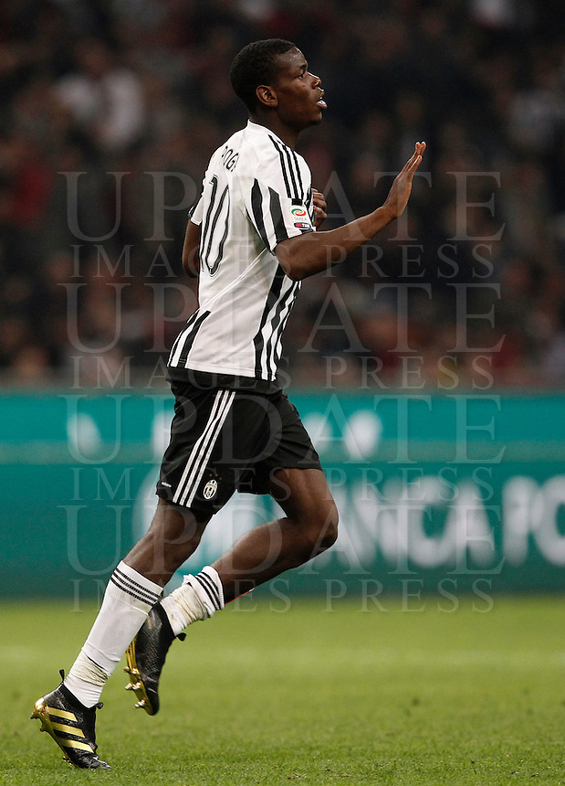 Calcio, Serie A: Milan vs Juventus. Milano, stadio San Siro, 9 aprile 2016. <br /> Juventus' Paul Pogba celebrates after scoring during the Italian Serie A football match between AC Milan and Juventus at Milan's San Siro stadium, 9 April 2016.<br /> UPDATE IMAGES PRESS/Isabella Bonotto