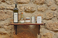 Various olive oil containers in fron to small shop, Monteriggioni, in the heart of Tuscany, Italy