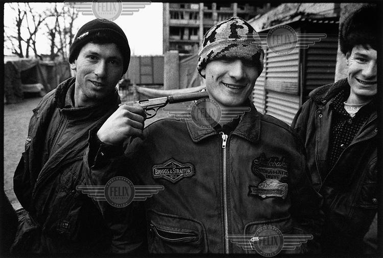 Photo and Copyright Leo Erken/NL12.CIS, Caucasus, Chechnya, Grozny, 1 1997, Petrol sold on the streets of Grozny. GOS, Kaukasus, Tsjetsjenië, Grozny, Verkoop van benzine in wekpotten op straat in Grozny. Verkoop van wapens op straat in Grozny. .