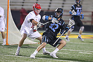College Park, MD - April 29, 2017: Johns Hopkins Blue Jays Shack Stanwick (32) holds off a Maryland Terrapins defender during game between John Hopkins and Maryland at  Capital One Field at Maryland Stadium in College Park, MD.  (Photo by Elliott Brown/Media Images International)