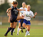 BROOKINGS, SD - SEPTEMBER 6:  Katherine Davison  #11 from Nevada battles for the ball with Shelby Raper #4 from South Dakota State University in the second half of their game Friday night in Brookings. (Photo by Dave Eggen/Inertia)