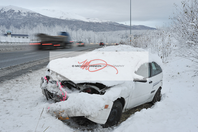 "A disabled car sits at the top of ""Brake Light Hill,"" Friday, Oct. 21, 2016 following the season's first snowtorm that hit Thursday night.  Photo for the Star by Michael Dinneen."
