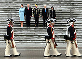 United States President Donald Trump (2L), with (L-R) first lady Melania Trump, Maj. Gen. Bradley Becker, Vice President Mike Pence and his wife Karen Pence review troops on the East Front of the U.S. Capitol on January 20, 2017 in Washington, DC. In today's inauguration ceremony Donald J. Trump becomes the 45th president of the United States. <br /> Credit: Michael Heiman / Pool via CNP
