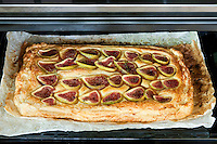 A delicious fig, ricotta, almond and honey tart as it emerges from the oven