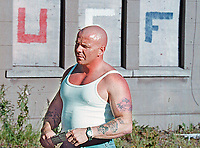 Johnny Adair, leader, &quot;C&quot; Company, UDA, Ulster Defence Association,   pictured in Clifton Park Avenue, Belfast, N Ireland, UK, waiting for the annual Tour of the North Orange Order parade which winds it way through North Belfast each marching season. Co-incidentally he is standing in front of UFF graffiti. The UFF, or to give it its full title, the Ulster Freedom Fighters, is widely recognised as a flag of convenience for the UDA. 15th June 2001. 200106159135<br />