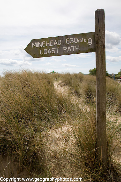 South West coastpath sign Studland, Dorset, England. The South West Coast Path National Trail offers 630 miles of superb coastal walking. The walk follows the coast from Minehead on the edge of the Exmoor National Park to the shores of Poole Harbour in Dorset.