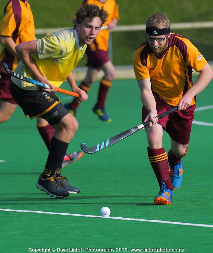 Action from the Wellington Hockey men's open grade premier two match between Upper Hutt 2 (maroon) and Northern United 2 (yellow) at National Hockey Stadium in Wellington, New Zealand on Sunday, 19 May 2019. Photo: Dave Lintott / lintottphoto.co.nz