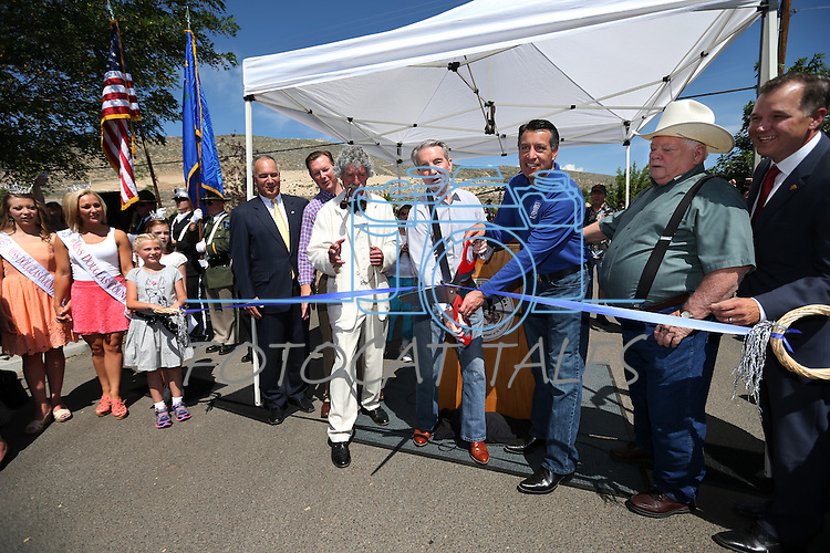 Dignitaries, including Carson City Mayor Bob Crowell and Gov. Brian Sandoval, center, cut the ribbon at a grand opening ceremony for the NV150 Fair at Fuji Park, in Carson City, Nev., on Thursday, July 31, 2014.<br /> Photo by Cathleen Allison/Nevada Photo Source