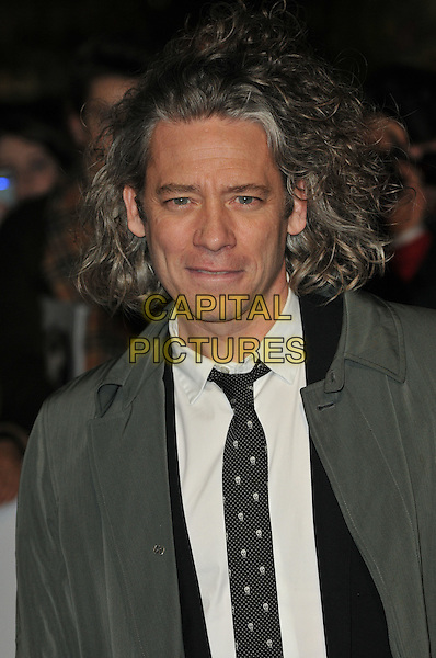 DEXTER FLETCHER.London Critics' Circle Film Awards at BFI Southbank, London, England..February 10th 2011.ALFS headshot portrait black white suit shirt grey gray trenchcoat trench coat messy hair.CAP/CAS.©Bob Cass/Capital Pictures.
