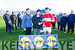 Dingle team captain Padraig O'Connor accepts the Dermot Earley Cup from Padraig O'Se and Mike Collins of Lidl having defeated Portdarlington in the senior football final in the Lidl Comórtas Peile Páidi Ó Sé 2019 in Gallarus on Sunday.