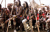 Lolgorian, Kenya. Moran warriors with white painted faces and legs at the Eunoto coming of age ceremony.