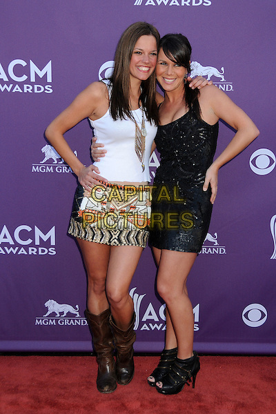 Amanda Watkins, Kasey Buckley, Miss Willie Brown.47th Annual Academy of Country Music Awards held at the MGM Grand, Las Vegas, Nevada, USA..April 1st, 2012.full length black white skirt top boots brown hand on hip CMA ACM.CAP/ADM/BP.©Byron Purvis/AdMedia/Capital Pictures.