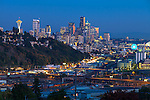 Seattle, Washington<br /> Night view of the city skyline and hillside homes of the Queen Ann neighborhood
