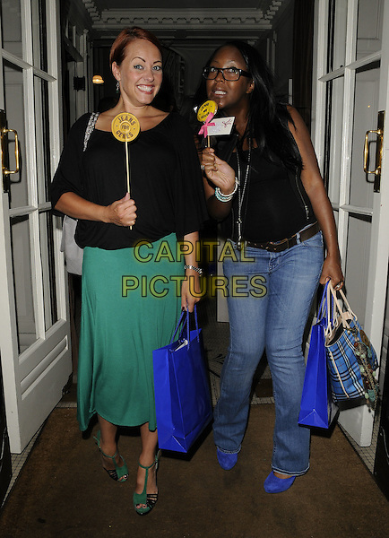SARAH CAWOOD & ANGELLICA BELL.Jeans for Genes launch party at Kettners, London, England..September 5th, 2011.full length jeans denim black sleeveless top glasses green skirt stick circle lollipop .CAP/CAN.©Can Nguyen/Capital Pictures.