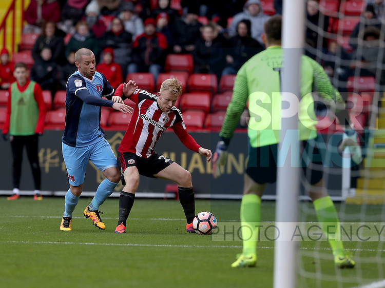 Mark Duffy of Sheffield United tussles with Alan Dunne of Leyton Orient inside the box during the Emirates FA Cup Round One match at Bramall Lane Stadium, Sheffield. Picture date: November 6th, 2016. Pic Simon Bellis/Sportimage