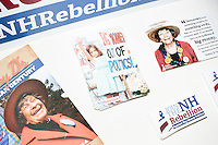 "Brochures and bumper stickers for NH Rebellion and the Stamp Stampede lay on a table after Harvard Law professor and Democratic presidential candidate Lawrence Lessig spoke at a meeting of the Salem Democrats at The Colosseum Restaurant in Salem, NH. This campaign event was Lessig's first visit to New Hampshire, though he had not yet raised the $1 million he wanted to raise before officially declaring his candidacy. The following week, Lessig raised the money and declared his candidacy. Lessig is running an unusual campaign, calling himself a ""referendum candidate."" He has said his campaign will focus on a single issue, The Citizen Equality Act, which would reform campaign financing, gerrymandering, and access to voting. Lessig has pledged that, if elected, once the Citizen Equality Act becomes law, he will immediately resign and turn the presidency over to his vice president."