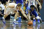 SIOUX FALLS, SD - NOVEMBER 30:  Jake Bittle #4 from South Dakota State University battles for the loose ball with Bernard Thompson #2 from Florida Gulf Coast in the first half of their game Sunday afternoon at the Sanford Pentagon in Sioux Falls. (Photo by Dave Eggen/inertia)