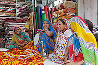 Indian women in cloth shop, Udaipur, India.