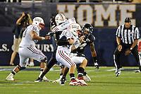 12 November 2011:  FIU linebacker Winston Fraser (34) sacks Florida Atlantic quarterback Graham Wilbert (14) in the third quarter as the FIU Golden Panthers defeated the Florida Atlantic University Owls, 41-7, to win the annual Shula Bowl game, at FIU Stadium in Miami, Florida.