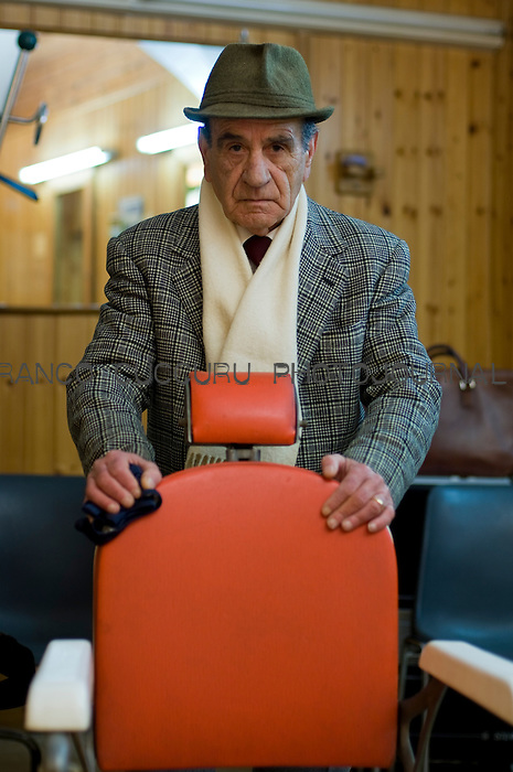 Barber. Mario Filippo Masia (73) posing in his shop in Via Università, Sassari