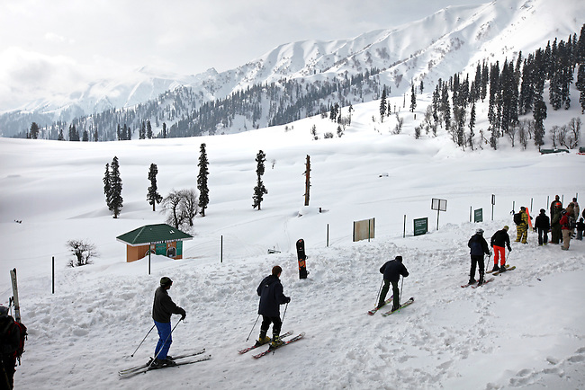 Skiers take off from the phase one Kongdori mid station of the northern hemisphere's highest gondola at the ski fields at Gulmarg in the disputed northern Indian state of Kashmir. 60 kilometres's from Srinagar tourists are drawn from all over the world for the cheap skiing and Indian experience.