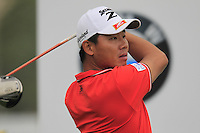 Wu Ashun (CHN) tees off the 1st tee during Saturay's Round 3 of the 2014 BMW Masters held at Lake Malaren, Shanghai, China. 1st November 2014.<br /> Picture: Eoin Clarke www.golffile.ie