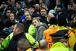 © Joel Goodman - 07973 332324 . 08/12/2015 . Manchester , UK . Police separate Borussia Monchengladbach and Manchester City fans after fans square off to each other during the UEFA Champions League match between Manchester City and Borussia Monchengladbach at the Etihad Stadium . Photo credit : Joel Goodman